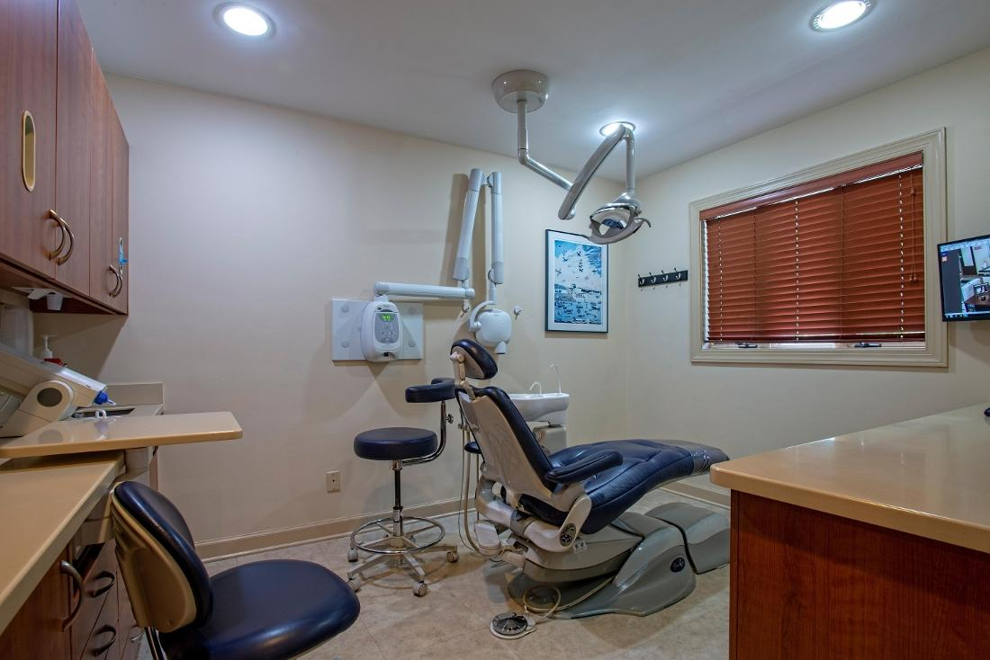 dental treatment room with chair and light at randolph dental associates