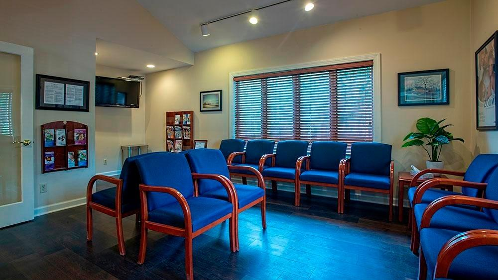 waiting area with chairs at randolph dental associates